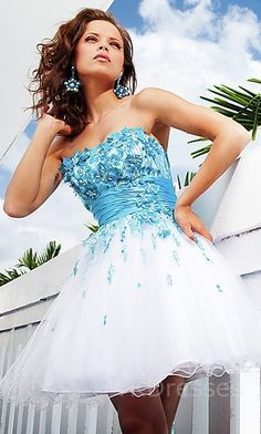 I love the blue scattered across the top of the dress.  The skirt is cute too!