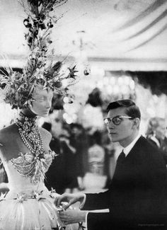 Christian Dior designer, Yves Saint Laurent, photo by Phillip Pollock, Harper's Bazaar, 1958