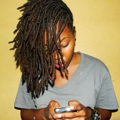 *not afrocentricitude     odelia-jay: »» that's me! & my iPod. lol.