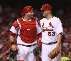 St. Louis Cardinals pitcher Justin Masterson talks with catcher A.J. Pierzynski after Pierzynski recovered the ball and threw out Cincinnati...