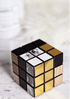 Gold and black and marble with wood - the wood is a little harsh but a white washed wood could work