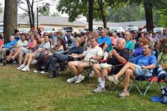 News-Herald photo — DEBBY HIGH A large crowd comes out to relax and enjoy the entertainment during the Perkasie Concerts in the Park performance by the Mango Men Wednesday, July 31.