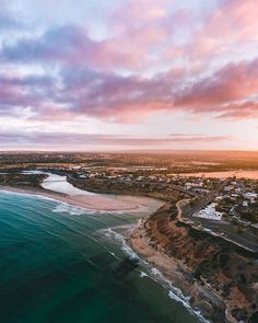 """South Australia on Instagram: """"Fairy floss skies over #PortNoarlunga 🌅 Just half an hour from the city, this picturesque seaside suburb is the perfect spot for swimming…"""" South Australia, Seaside, Swimming, Sky, River, Mountains, Fairy, Outdoor, Posts"""