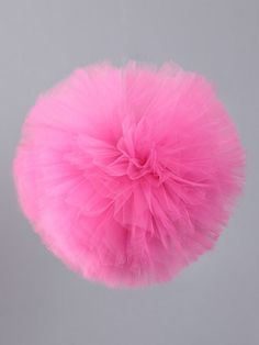 fun tulle pom poms, hang these by a string to decorate!
