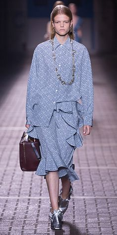 Mulberry Summer '17 LFW show. Keira Shirt in blue, Aya skirt in blue, Frills mules in silver, Hopton bag in midnight, white & burgundy, Casse tete necklace in silver tone.