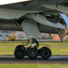 United Boeing 777 (N77022) main landing gear impact seen here