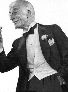 White waistcoat, black tie.  1935