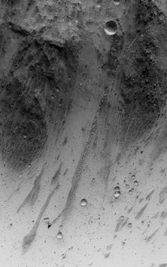 """An Irregular, Upright Boulder on Mars   NASA MRO -  This image was targeted to cover part of a small """"chaos"""" terrain, where there are lots of steep slopes. The trail has a odd repeating pattern, as if the boulder couldn't roll straight due to its shape. - Image Credit: NASA/JPL/University of Arizona - via Friends of NASA's photo on Google+"""