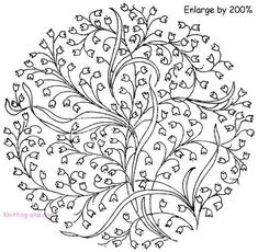 Detailed embroidered circle with flower design