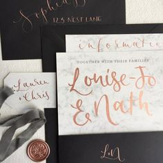 Dolomite wedding invitations featuring white and grey marble, metallic rose gold handpainted details, and jet black and wax seal finishes.