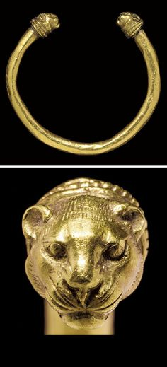 A GREEK GOLD BRACELET   CLASSICAL PERIOD, CIRCA 5TH CENTURY B.C.   The penannular hoop round in section, with lion-head terminals joined to the ends by a cylindrical collar, a small beaded wire at the join, a larger beaded wire framed by plain wire behind the heads, each lion head with an incised radiating mane, the short rounded ears high on the head, the eyes bulging within the recessed sockets, the whiskers incised  3¼ in. (8.3 cm.) wide