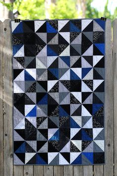 The finished quilt measures: 32 x 52 inches*. It is quilted with straight lines to compliment the design, which adds a wonderful character and softness to the drape of the quilt.  The back of the quilt features a Star Trek fabric, and is hand bound in black. Warm and Natural batting is used. The quilt is machine washable (gentle cycle), although line drying is preferred, tumble drying is also an option.  This quilt is new and unused, it was made and is kept in a smoke-free home and would…