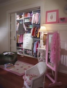 Little girls dream closet by Saint Louis Closet Co. includes triple hanging rods and accessible shoe shelves and drawers.