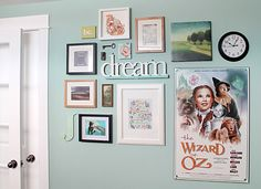 I love this gallery wall AND I totally have that Wizard of Oz sign so I could definitely do this!:) lol