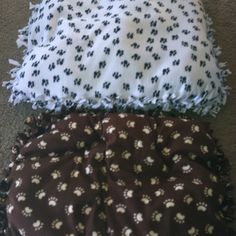 handmade dog beds using the no sew blanket technique. Just add some filler inside and there you go! I hope the doggies like them!!