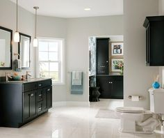 bright bathroom with black cabinets