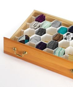 Banish the tangle of socks and underwear in the drawer with this honeycomb organizer. This handy helper ensures convenient, customized containment.