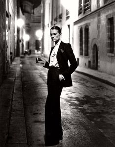 fashion photography legend Helmut Newton in 1975 for French Vogue, advertising the Yves Saint-Laurent Le Smoking Tuxedo for women