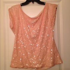 HP Gorgeous sequined tunic✨ Host Pick: 12/29: Showstopping Style Party Stunning baby pink tunic with iridescent sequins all over.  Inside is lined with a matching chiffon lining (some pulls as indicated in picture) but no missing or broken sequins on the tunic. Express Tops Tunics