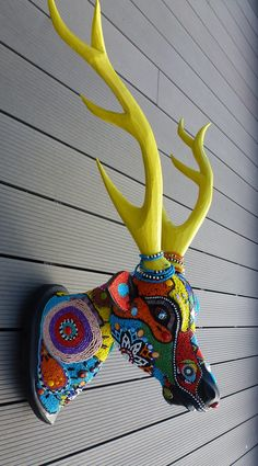 wooden deer head and beads