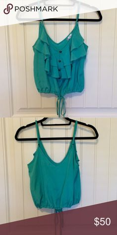 Teal cropped tank top Super cute teal cropped top. Ties at bottom. Purchased from a boutique in NY. Worn once. Perfecg condition Tops Crop Tops