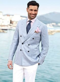 Shop this look on Lookastic:  http://lookastic.com/men/looks/double-breasted-blazer-dress-shirt-dress-pants-tie-pocket-square/10646  — Pink Dress Shirt  — Navy Geometric Tie  — Pink Pocket Square  — Light Blue Double Breasted Blazer  — White Dress Pants