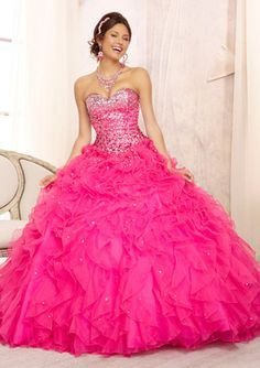 Beaded Bodice on a Ruffled Organza Skirt. Matching Bolero Included. Colors Available: Coral, Hot Pink, Light Aqua, White. Quinceanera Dress #88096
