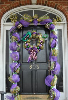 I have always loved how the doors of New Orleans homes are decorated at Mardi Gras, especially the old homes along the St Charles Ave parade route.