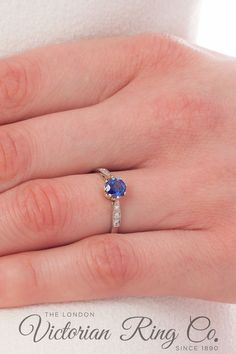 The beautiful blue sapphire in this platinum engagement ring is held in an 8-prong setting. The shoulders of the ring are tapered and on each side three small round diamonds are set. The millegrain edging gives the ring its vintage style. #millegraindetailing #sapphirering #sapphireengagementring #bluesapphirering #vintagestyleengagementring Vintage Style Engagement Rings, Platinum Engagement Rings, Deco Blue, Blue Sapphire Rings, Art Deco Jewelry, Vintage Diamond, Unique Rings, Ring Designs, Round Diamonds