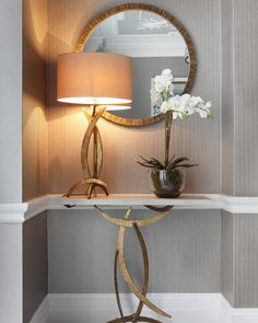 French Brass Miro console table with Miro lamp and Trevose mirror, all by Porta Romana.