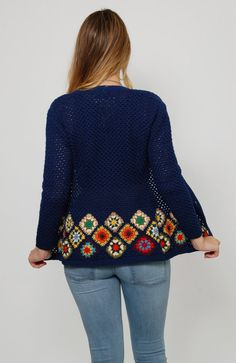 Super cute 70s Granny square cardigan! This comfy little layering piece is made of a navy blue open knit with small yarn cover buttons down the front. It has long sleeves, a round neckline and the bottom is filled with rainbow colored Granny squares. So adorable worn over just about anything!  Measurements Size: App XS/S Shoulder: 16 Sleeve from underarm to end: 16 Bust: 36 Waist: 28 Length: 24  Details Circa: 1970s Color: Navy blue/mixed Material: Lightweight wool knit Label: Maskit Made…