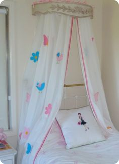 Make a beautiful bed canopy from curtains - a Pottery Barn Kids knock off