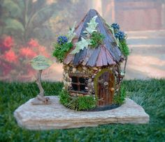The Doors to this Fairy Cottage do not open.  This little fairy cottage would be perfect for a covered patio placed in a potted fairy garden. because of the silk flowers I would not place it in direct sun light the silk leaves may fade. Included with this fairy cottage is a little fairy box. If you have young children they will enjoy leaving notes to the fairies.  Size: 9 1/2 in. tall/ 5 in. wide