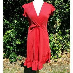 """VINTAGE Sexy Red Dress Vintage HOT! Absolutely gorgeous red! This dress is made for dancing! Inside the red is more of a tomato red. The only issue is one tiny snag shown in pic 4. Also there are belt-loops but no belt. Hi low from side to side with a pretty ruffle at the hem and sleeves.  Vintage size 7. Unstretched flat measurements: chest 18.5, waist 16, length 40"""". Very stretchy, not listed but pretty sure polyester. Vintage  Dresses Asymmetrical"""