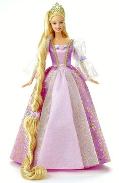Barbie - Rapunzel----I remember this doll. you could gently tug down her hair to make it go a bit longer.
