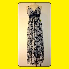 Black & White paisley maxi. New without tags. Sz 6 This black and white dress features paisley pattern and crochet waist and straps. The straps and the bust flatters bust. With its embroidery and color, this is a great dress for cocktails, cruise or that garden party, that can be worn from morning til the wee hours of the morning.                                                           Fully lined.                                                            Embroidery straps and waist…