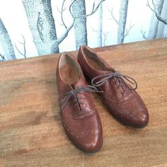"""Clarks Indigo Charlie Brogues Oxford- Brown Take some style inspiration from his closet and slip into the Indigo by Clarks Charlie Brogue. This man-tailored leather oxford has handsome wing-tip detailing, soft leather linings, and an extra-padded footbed that cushions the foot in comfort. Step out in this classic wing tip style with feminine flair.                                                    Leather. Synthetic sole Heel measures approximately 0.75"""".                        Wingtip…"""