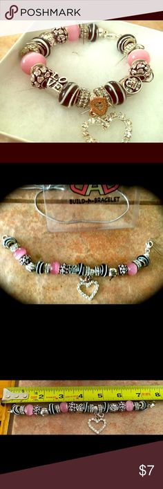 "Pink Beaded Bracelet w/Heart Charm 7"" Pink and Silver Beaded bracelet. It's has a nice sparkling heart charm! Jewelry Bracelets"