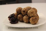 Khajoori Farhali Laddoo: Dates sauteed with dried fruits, fresh coconut, semolina and powdered sugar and shaped into laddoos.