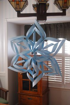 I made this large snowflake using cardstock paper, tape and staples... makes a nice winter decor :)