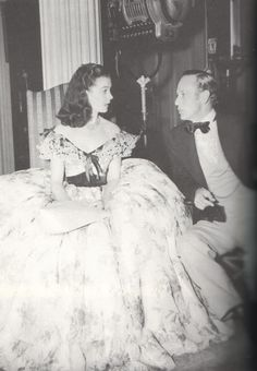 Vivien Leigh chatting with Leslie Howard, on the set of Gone With The Wind (1939)