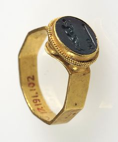 Finger Ring Date: 6th-7th century Geography: Made in, Nothern France Culture: Frankish Medium: Gold, intaglio Dimensions: Overall: 7/8 x 13/16 x 3/8 in. (2.3 x 2 x 1 cm) bezel: 1/2 x 3/8 x 3/16 in. (1.2 x 1 x 0.4 cm) Accession Number: 17.191.102 The Metropolitan Museum of Art