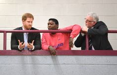 Prince Harry Photos Photos - Prince Harry (L) with Ady Hinds (C) founder of Pink Lizard and mentor Steve White during a visit to a sports session organised by the Pink Lizard youth organisation, on the Saffron Lane estate on March 21, 2017 in Leicester, England. - Prince Harry Visits Leicester