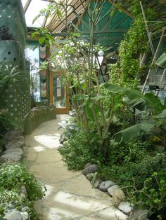 Earthship greenhouse mine would have more edibles not tropicals pretty but ya can t eat em Earthship Design, Earthship Home, Natural Building, Green Building, Building A House, Natural Homes, Greenhouse Plans, Indoor Greenhouse, Earth Homes