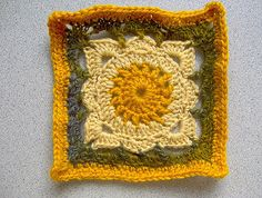 https://flic.kr/p/jNumA   willow granny square II   more playing with the japanese garden handspun.  gold thrifted at MCC, van.