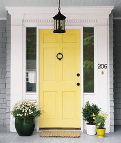 Traditional Wood Raised Panel - Front Door Ideas - Bob Vila like the wrought iron touch as well, with white trim