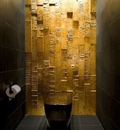 All you need is some gold paint to create magic in the dark bathroom! [Design: Dorothee Junkin Design Studio]