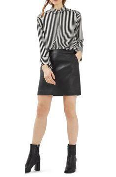 Professional with an edge—just like you—this pencil skirt features a sleek, high waist and soft, faux leather for polished day-to-night style.