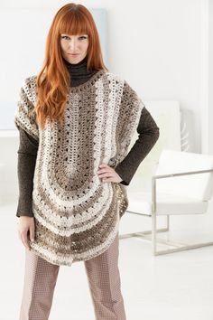 Make this trendy crochet poncho with Lion Brand Scarfie! Free pattern calls for 3 balls of yarn (pictured in cream/taupe) and a size K-10.5 (6.5mm) crochet hook.