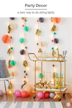 "Light up your next party with this garland DIY: Hang Oh Joy! for Target's dotty string lights vertically and add on colorful extras. 1. Cut a length of twine and clip it to each garland. 2. Attach honeycomb balls to the twine with gold twist ties. 3. Cut a gold fringe banner into sections (about 11"" each) and gather them into tassels. 4. Secure each tassel to the garland with a gold twist tie. (Don't worry about spacing to specific measurements; an organic feel adds whimsy to this festive…"